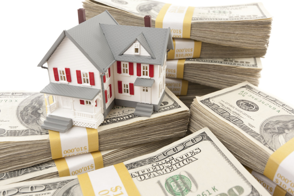 House on Stacks of Money from Home Equity Loans in DC